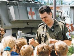 Canadian medic entertains and Bosnian children