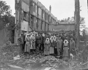 Canadian Army Medical Corps medical staff in rubble of bombed hospital in France