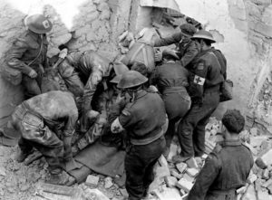 Stretcher bearers recovery casualty from rubble during Italian campaign