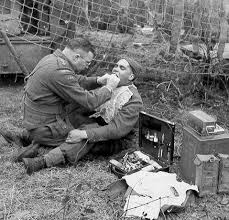 Soldier being treated for a facial wound