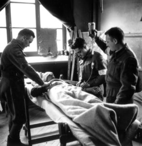 Patient receiving transfusion in an Advance Dressing Station (ADS) in Italy