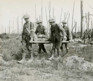 Stretcher bearers carry wounded from battlefield.