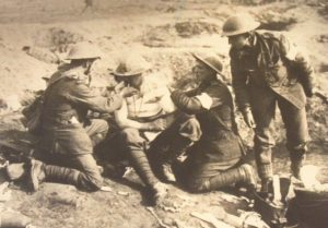 Stretcher Bearers provide first aid to wounded soldier in frontlines.