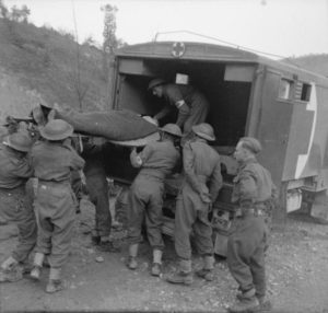 Patient being loaded in to ambulance in Italy