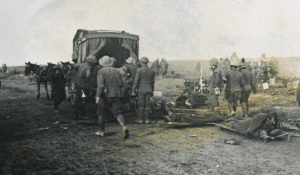 Casualties being loaded on a horse drawn ambulance