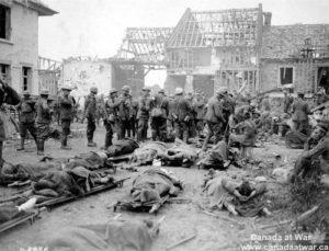 German prisoners of war awaiting medical care in destroyed Belgium village