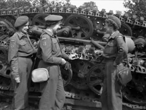 RCAMC nursing sisters examining the wreckage of a German tank Source: TBC