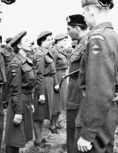 Lieutenant-General G.G. Simonds, General Officer Commanding 2 Canadian Corps, inspecting the personnel of No.2 Casualty Clearing Station (RCAMC), Oldenburg, Germany, 2 June 1945. Source: TBC