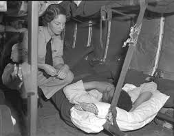 Royal Canadian Air Force nursing sister chatting with a patient from the Korean War as they take off for Canada Source: TBC